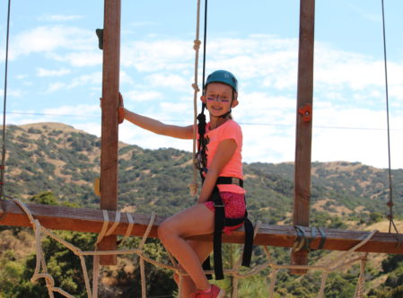 girl on ropes course