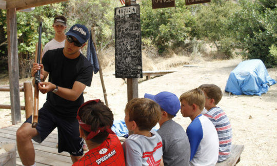 campers being instructed on proper use of the air rifles