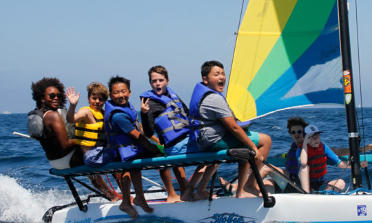 campers having fun on one of the sailboats