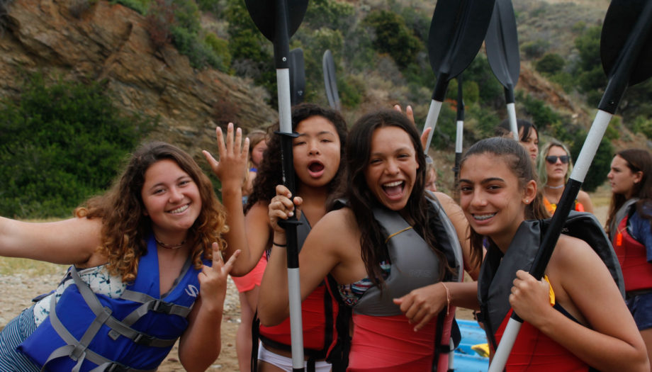 girls holding oars getting ready to kayak